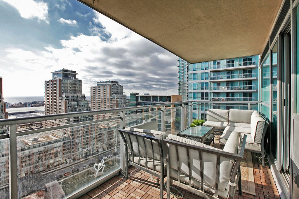 1 bedroom den corner suite for sale in liberty village for Condo balcony furniture